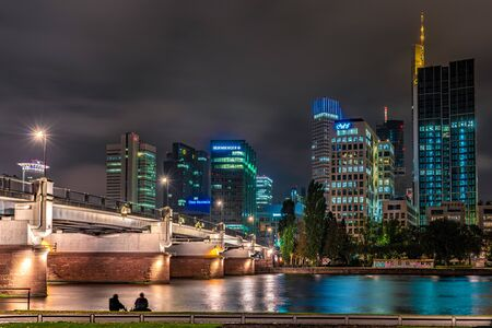 FRANKFURT, GERMANY - SEPTEMBER 25: This is a night view of the financial district city skyline along the river main on September 25, 2019 in Frankfurt 에디토리얼