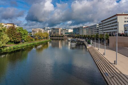 SAARBRUCKEN, GERMANY - SEPTEMBER 23: This is a view of city buildings and a riverside path along the River Saar on September 23, 2019 in Saarbrucken 에디토리얼
