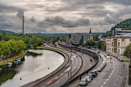 SAARBRUCKEN, GERMANY - SEPTEMBER 23: This is a scenic view of Saarbrucken with a motion blur of cars driving along a road  on September 23, 2019 in Saarbrucken