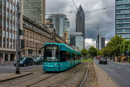 FRANKFURT, GERMANY - SEPTEMBER 25: View of a tram driving through the downtown financial district area on September 25, 2019 in Frankfurt 에디토리얼