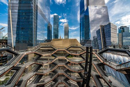 NEW YORK, USA - OCTOBER 07: This is the Vessel structure and modern skyscrapers buildings at Hudson Yards on October 07, 2019 in New York