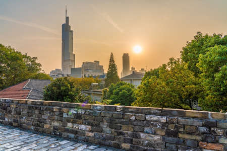 NANJING, CHINA - NOVEMBER 09: This is the Nanjing ancient city wall with a view of the ZIfeng tower during sunset on November 09, 2019 in Nanjing