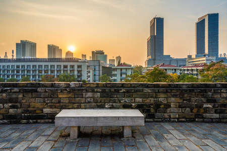 NANJING, CHINA - NOVEMBER 09: This is a view of the Nanjing ancient city wall and downtown city buildings during sunset on November 09, 2019 in Nanjing
