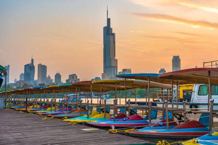 NANJING, CHINA - NOVEMBER 08: This is a pier with colorful boats on Xuanwu Lake during sunset on November 08, 2019 in Nanjing
