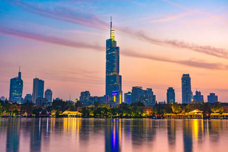 NANJING, CHINA - NOVEMBER 09: This is an evening view of Zifeng Tower and downtown city buildings from Xuanwu Lake on November 09, 2019 in Nanjing