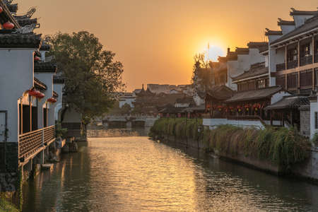 NANJING, CHINA - NOVEMBER 10: Old town architecture along the Qinhuai River in the Fuzimiao historic district during sunset on November 10, 2019 in Nanjing Editorial