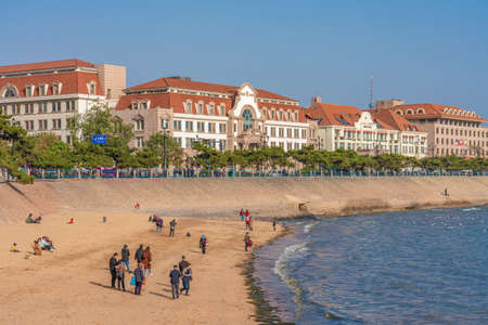 QINGDAO, CHINA - NOVEMBER 12: View of a beach and traditional colonial style buildings along the waterfront on November 12, 2019 in Qingdao
