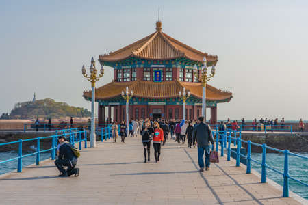 QINGDAO, CHINA - NOVEMBER 12: Traditional Chinese pavilion on Zhanqiao pier, a famous travel destination on November 12, 2019 in Qingdao