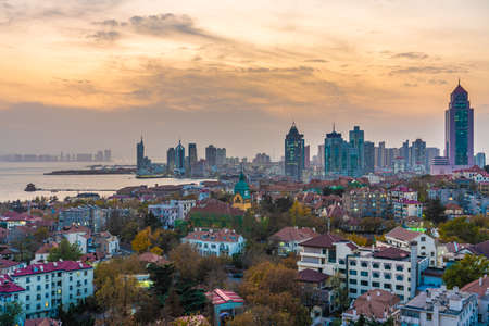 QINGDAO, CHINA - NOVEMBER 12: This is a city view of Qingdao in the Zhongshan Road district during sunset on November 12, 2019 in Qingdao