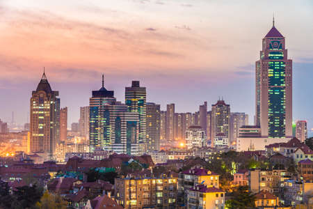 QINGDAO, CHINA - NOVEMBER 12: This is an evening view of city buildings in the Zhonshan Road district on November 12, 2019 in Qingdao