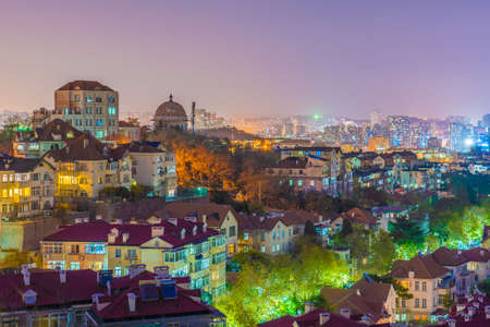 QINGDAO, CHINA - NOVEMBER 12: Night view of traditional houses and city buildings in the Jiangsu Road Residential district on November 12, 2019 in Qingdao Editorial