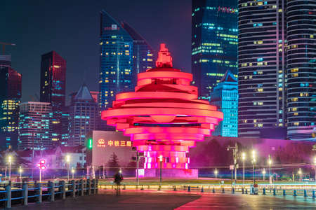 QINGDAO, CHINA - NOVEMBER 13: Night view of the May Fourth Square monument and financial district city buildings on November 13, 2019 in Qingdao Editorial