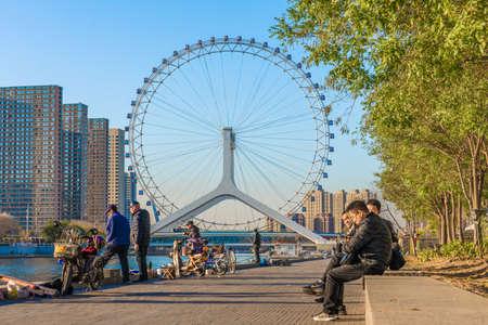 TIANJIN, CHINA - NOVEMBER 19: Riverside view of the Tianjin Eye, a famous landmark in the downtown area along the Hai River on November 19, 2019 in Tianjin Editorial