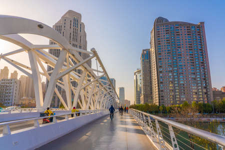 TIANJIN, CHINA - NOVEMBER 18: Cityscape of a modern bridge and buildings in the downtown area on November 18, 2019 in Tianjin