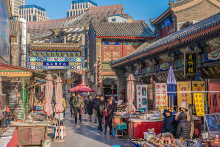 TIANJIN, CHINA - NOVEMBER 18: This is an antique market where vendors sell traditional Chinese items in the Tianjin Ancient Culture Street on November 18, 2019 in Tianjin