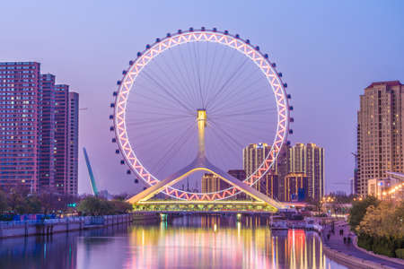 TIANJIN, CHINA - NOVEMBER 18: Evening view of the Tianjin Eye, a famous landmark in the downtown area on the Hai River on November 18, 2019 in Tianjin