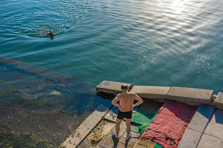 TIANJIN, CHINA - NOVEMBER 19: Chinese people swimming in the Hai River in the city area on November 19, 2019 in Tianjin Editorial