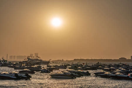QINGDAO, CHINA - NOVEMBER 14: This is a scenic view of boats docked along the harbor at sunset on November 14, 2019 in Qingdao Editorial