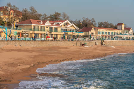 QINGDAO, CHINA - NOVEMBER 15: View of a local beach with waterfront buildings and cafes at Badaguan Scenic area on November 15, 2019 in Qingdao