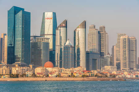 QINGDAO, CHINA - NOVEMBER 15: Cityscape of modern skyscrapers and traditional buildings along the waterfront area on November 15, 2019 in Qingdao Editorial