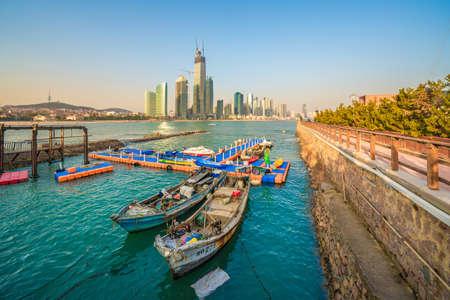 QINGDAO, CHINA - NOVEMBER 15: Docks with local fishing boats in the sea at Badaguan scenic area on November 15, 2019 in Qingdao