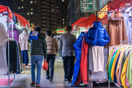 QINGDAO, CHINA - NOVEMBER 14: Stalls in Taidong Night Market, a famous tourist destinatio and shopping area on November 14, 2019 in Qingdao