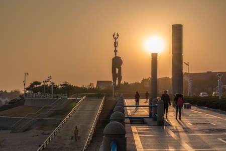 QINGDAO, CHINA - NOVEMBER 15: View of a waterfront promenade during sunset on November 15, 2019 in Qingdao