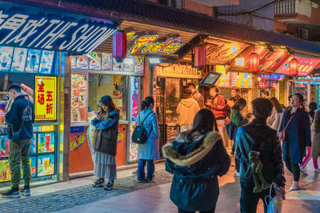 QINGDAO, CHINA - NOVEMBER 15: Street food stalls in Taidong night market, a famous tourist destination on November 15, 2019 in Qingdao