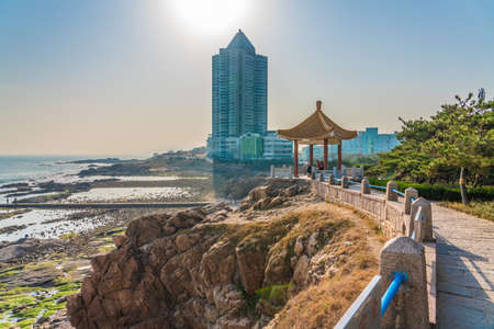 QINGDAO, CHINA - NOVEMBER 15: View of a Chinese pavilion on a cliff at Badaguan scenic area on November 15, 2019 in Qingdao