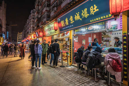 QINGDAO, CHINA - NOVEMBER 15: Street food vendors and restaurants at the famous Taidong night market on November 15, 2019 in Qingdao