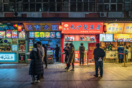 QINGDAO, CHINA - NOVEMBER 15: Street food vendors in the famous Taidong night market, a popular travel destination on November 15, 2019 in Qingdao