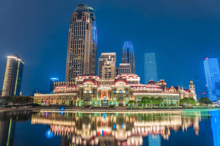 TIANJIN, CHINA - NOVEMBER 16: This is a night view of traditional european style buildings and city skyscrapers along the Hai River on November 16, 2019 in Tianjin