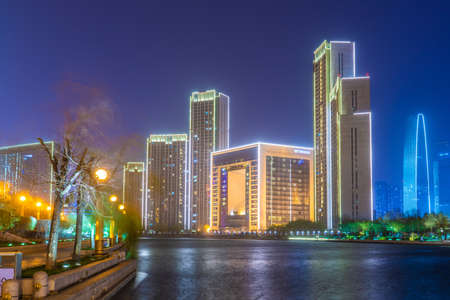 TIANJIN, CHINA - NOVEMBER 17: Night view of modern city buildings in the downtown area along the River Hai on November 17, 2019 in Tianjin Stock Photo - 147381504