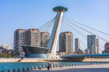 TIANJIN, CHINA - NOVEMBER 18: This is a view of a modern landmark bridge along the Hai River on November 18, 2019 in Tianjin