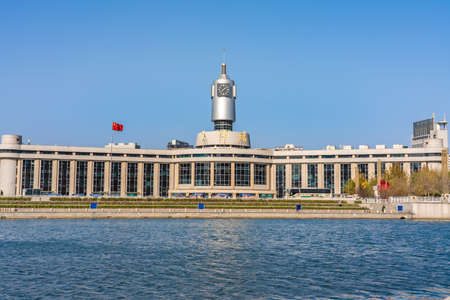TIANJIN, CHINA - NOVEMBER 18: View of the exterior architecture of Tianjin Railway Station on the Hai River on November 18, 2019 in Tianjin Editorial