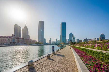 TIANJIN, CHINA - NOVEMBER 18: Riverside walking path along the Hai River in the downtown area on November 18, 2019 in Tianjin