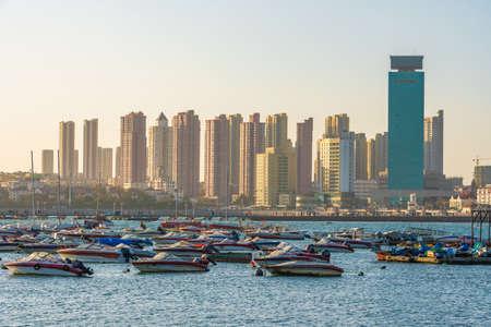 QINGDAO, CHINA - NOVEMBER 14: View of boats docked along the harbor near Zhanqiao Pier on November 14, 2019 in Qingdao Stock Photo - 147381548