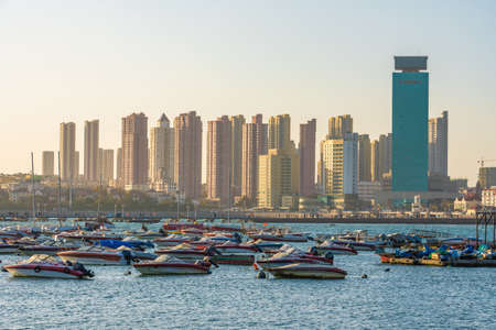 QINGDAO, CHINA - NOVEMBER 14: View of boats docked along the harbor near Zhanqiao Pier on November 14, 2019 in Qingdao
