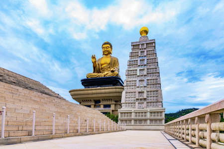 Buddha statue with cloudy sky in the evening