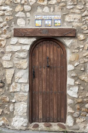alava: Decorated wooden door at its upper end with Rural Basque scenes Stock Photo