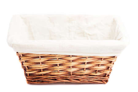 wicker basket isolated on a white background photo