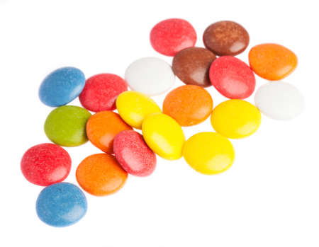 some smarties closeup on a white background photo