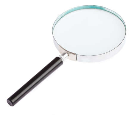 magnifying glass laying on a white background Фото со стока