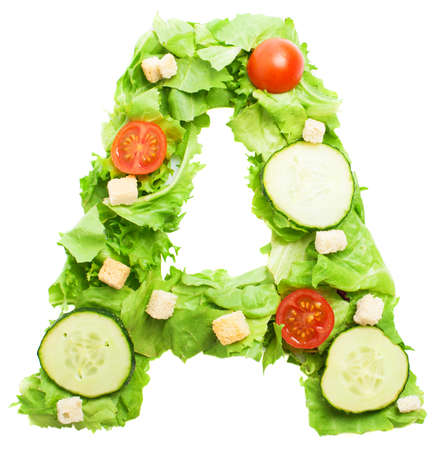 A letter made with salad isolated on white photo