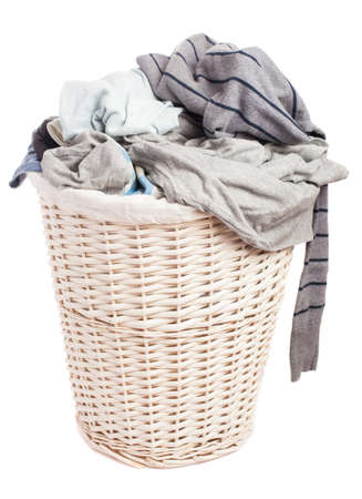 dirty clothes in a basket on a white background