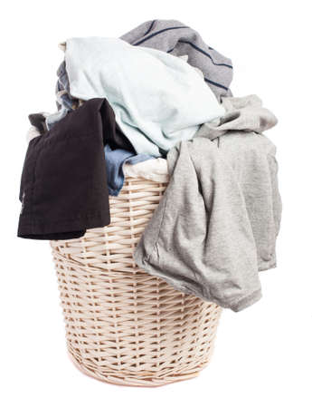 dirty clothes: dirty clothes in a basket on a white background