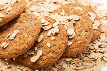 extreme close up oats and biscuit on a white background photo