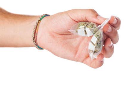 illegal trading: man trading marijuana isolated on a white background
