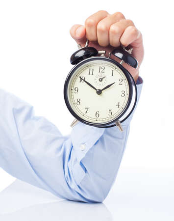 hand holding alarm clock isolated on a white background Imagens