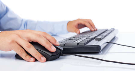 businessman using computer on a white background